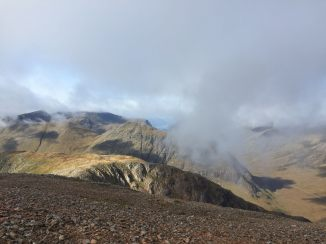 Descending from Stob Dearg, looking west. Glen Coe itself is bottom right. Lochs Linnhe and/or Leven visible center.