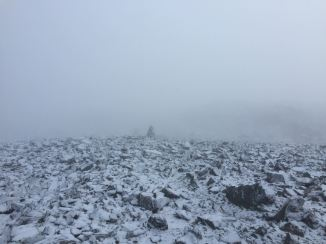 A gray world—following cairns towards the summit