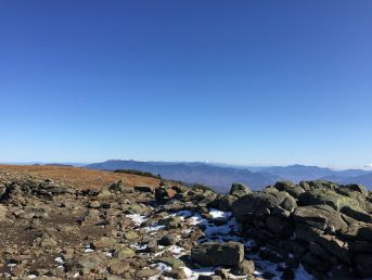 Moosilauke summit - snowcapped Presidential Range center, far distance; Franconia Ridge left of center, middle distance