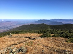 The Appalachian Trail leaves Moosilauke summit heading north