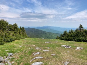 On (or very near) the summit. Camel's Hump, 10 miles distant, is visible just right of center. Mount Mansfield—farther off, hazier—is tucked behind the Hump. The bare foreground is a Sugarbush Resort ski run